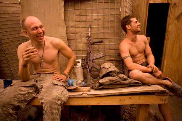 Specialist Misha Pemble-Belkin (l.) and Ross Murphy (r.) of Battle Company, 173rd US Airborne relax at Outpost Restrepo. Korengal Valley, Afghanistan, Kunar Province. 2008. Photograph © Tim Hetherington