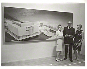 Betty Asher and Henry Hopkins in Front of Ed Ruscha's Painting Los Angeles County Museum on Fire