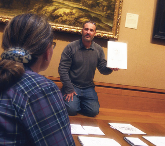 Artist Stas Orlovski leads a discussion of participants' portrait sketches at Getty Drawing Hour.