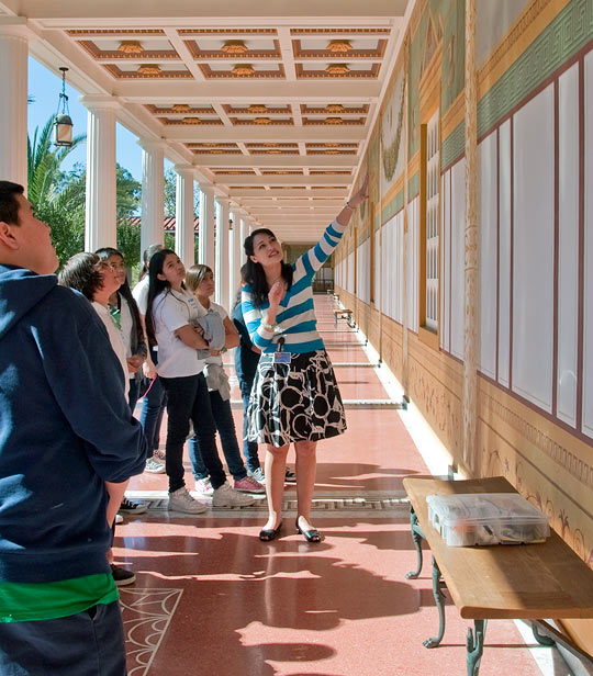 Gallery teacher Kristen Kido leading a tour in the Outer Peristyle at the Getty Villa