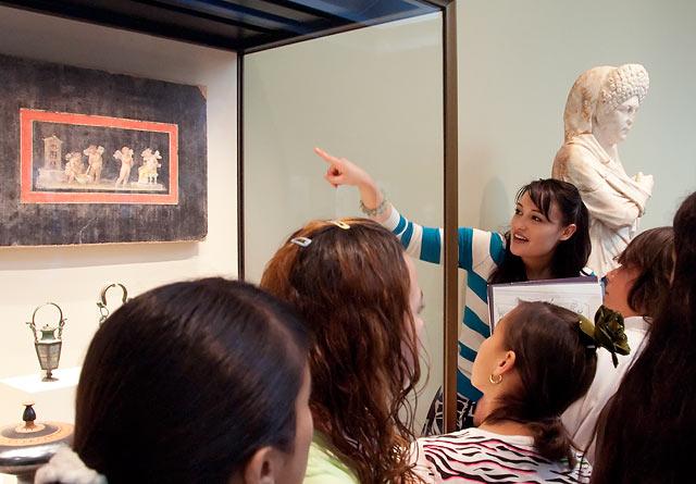 Gallery teacher Kristen Kido leading a tour in the Getty Villa galleries