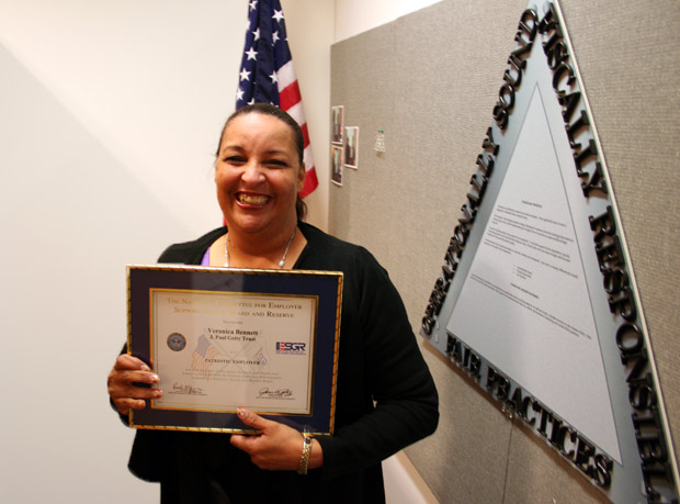 Veronica Bennett shows off the Patriotic Employer Award.