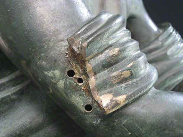 Right arm of the Apollo Saettante showing three drill holes