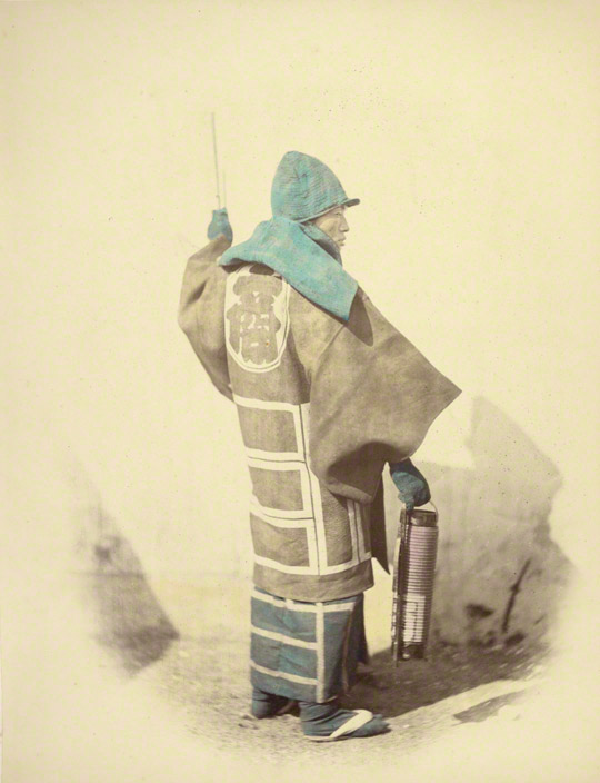 <em>Fire Master</em>, Felice Beato, 1866–67. Hand-colored albumen silver print in Views of Japan (1868). 10 7/16 x 8 in. The J. Paul Getty Museum, 84.XO.613.26