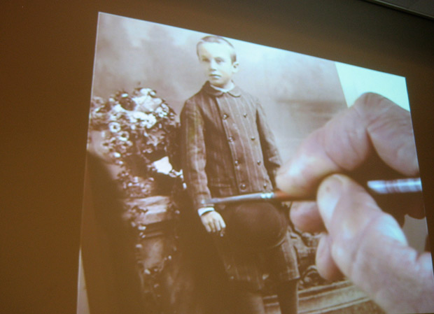 Luther Gerlach hand-colors a sepia photograph at an Artist-at-Work Demonstration