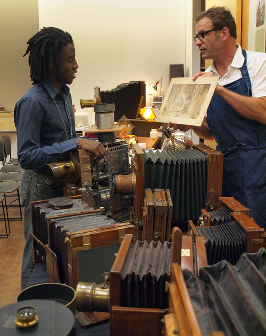 Luther Gerlach shows off some of his 19th-century cameras and equipment in the Museum Studios at the Getty Center