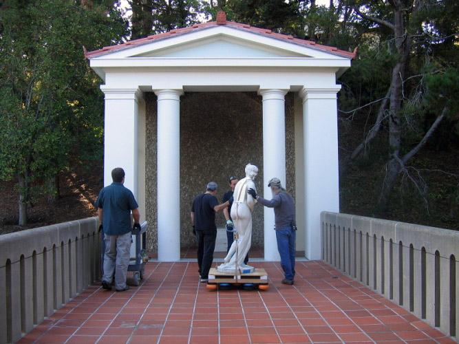 Installation of the Touch Statue at the Getty Villa in 2009; above, visitors explore the statue.