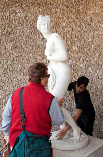 Visitors explore the Touch Statue, a 20th-century replica of Venus after Antonio Canova