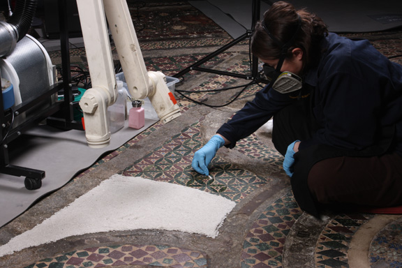 Conservators used a poultice solvent cleaning method on the pavement, using paper pulp and Shellsol T. Courtesy of Westminster Abbey.