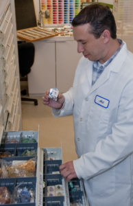 The Getty Conservation Institute's Art Kaplan, examining mineral samples found in the Reference Collection.