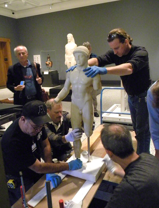 The Agrigento Youth being fitted onto its new pedestals by conservators and mount makers at the Getty Villa