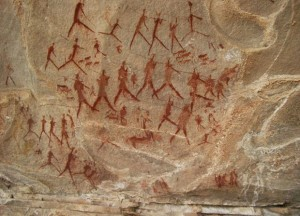 Rock art in Leliekloof, Eastern Cape, South Africa. Processions of people are typical of dancing scenes associated with altered states of consciousness. The sheep and dogs indicate that the paintings are less than 2,000 years old. Photo: Janette Deacon