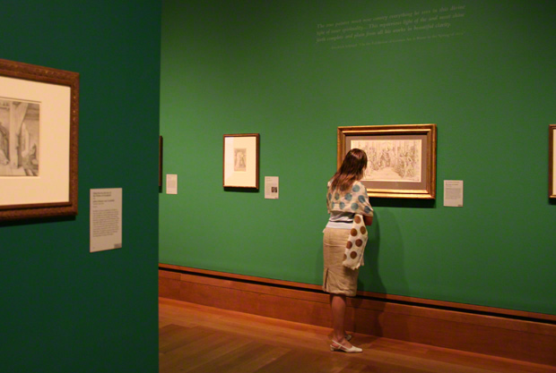 Visitor in the emerald green galleries of the exhibition Spirit of an Age at the Getty Center