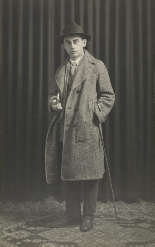 <em>Untitled (Self Portrait with Pipe, Paris)</em>, Man Ray, 1921. The J. Paul Getty Museum, 97.XM.54.1