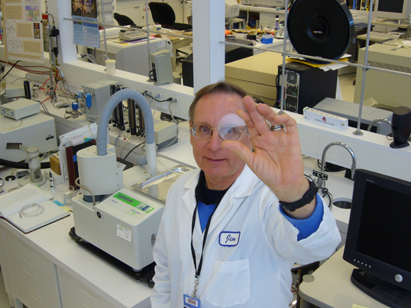 Getty Conservation Institute scientist Jim Druzik holding one of several filters being evaluated for use in conservation lighting.