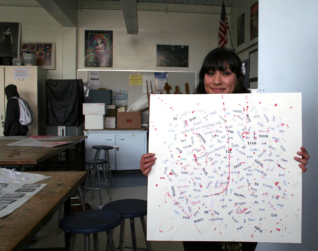 A student with her song-lyric collage made from Mark Bradford's RE-RE-Process activity in Open Studio