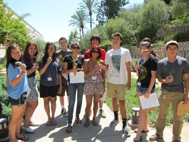 Students in the Academia Aestiva Latina show off their bouquets garnis in the Getty Villa's Herb Garden