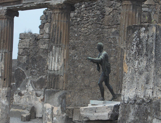 Chiurazzi replica of a Roman bronze sculpture of Apollo as an Archer in the ruins of Pompeii