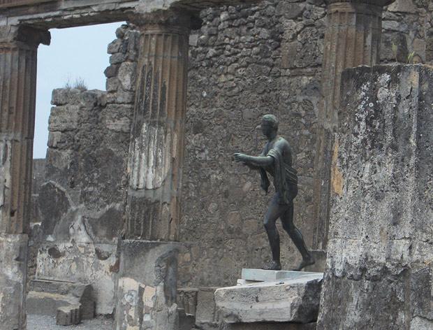 Chiurazzi replica of a Roman bronze sculpture of Apollo as an Archer in the ruins of Pompeii