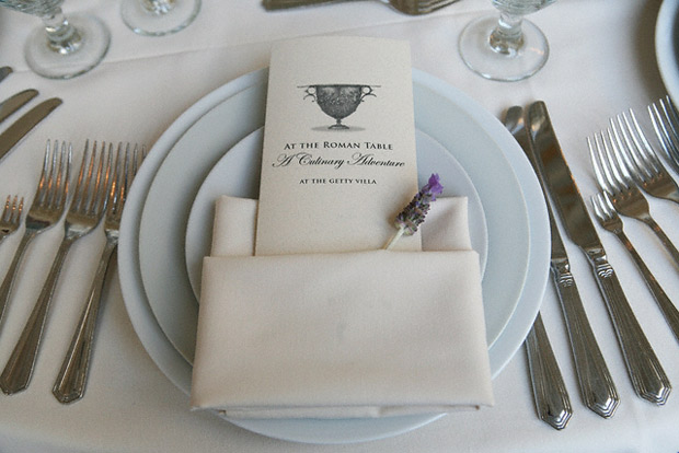 Place setting with menu for At the Roman Table at the Getty Villa