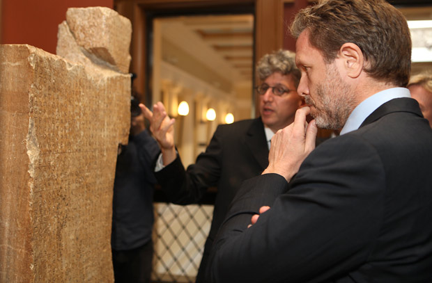 Pavlos Yeroulanos and Kenneth Lapatin, associate curator of antiquities, view the inscribed religious calendar of Thorikos