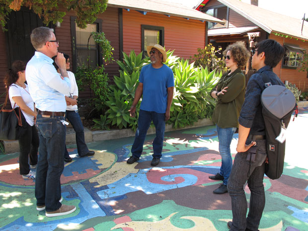 GCI staff enjoying a tour of St. Elmo Village with co-creator and director Roderick Sykes (center).