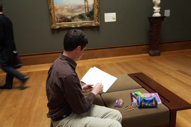 William Zaluski sketching J.M.W. Turner's Modern Rome at the Getty Center