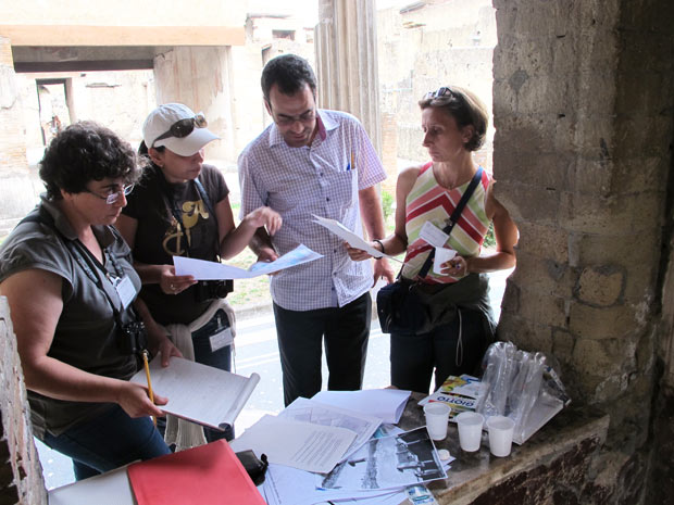 MOSAIKON course participants at the site of Herculaneum, Italy, preparing and presenting a site exercise on planning priority conservation interventions.