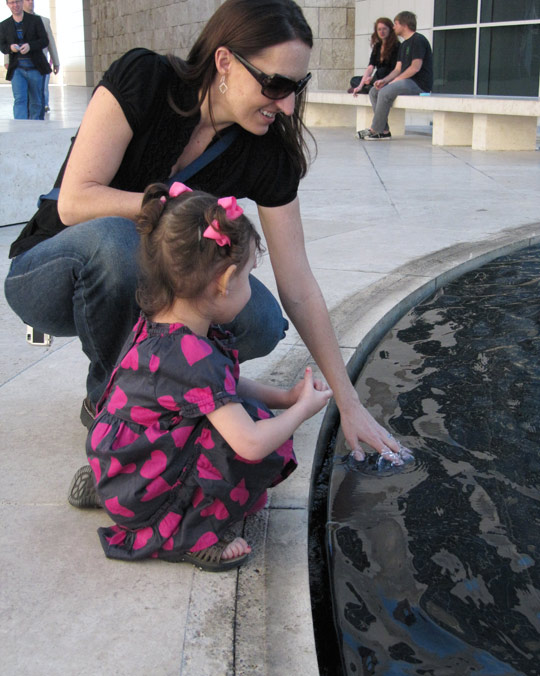 Mom and daughter enjoy one of the fountains at the Getty Center
