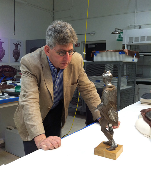 Antiquities curator Kenneth Lapatin with the Mercury statuette in the antiquities conservation studio at the Getty Villa