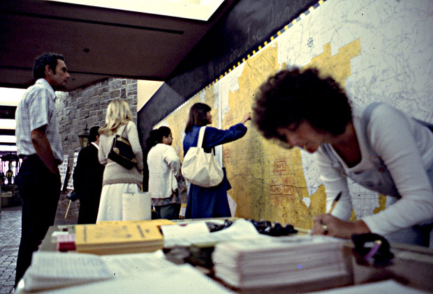 Hotline activist in front of the Rape Map, May 1977