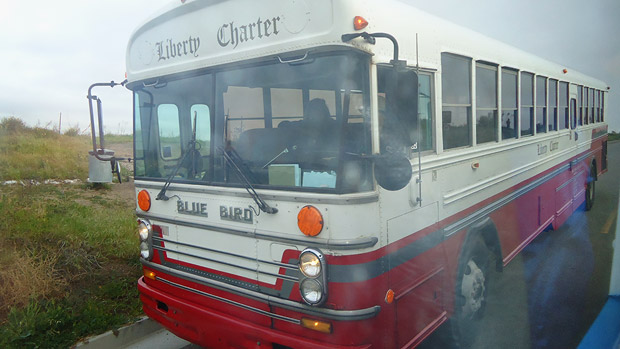 A charter bus takes participants to Lita Albuquerque&#039;s Spine of the Earth 2012