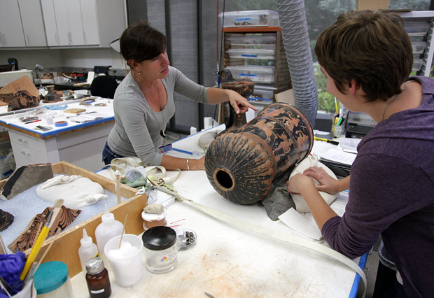 Marie Svoboda and Teresa Navarro-Gomez working with a loutrophoros from the Berlin Antikensammlung in the conservation studios at the Getty Villa.