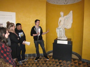 Teenage apprentices discuss the Roman marble of Leda and the Swan in the Temple of Herakles at the Getty Villa