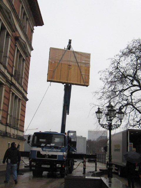 Crated artwork is lifted by crane into the galleries of the Martin-Gropius-Bau for the Pacific Standard Time exhibition