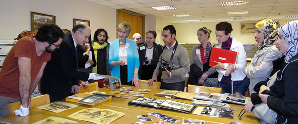 Participants in a photographs conservation training course in Beirut, Lebanon, view historic black and white photos