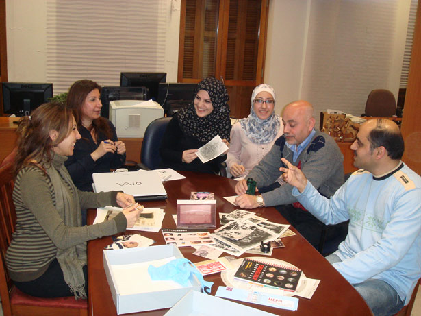 Participant in a photographs conservation training course held in Beirut gives a presentation to colleagues