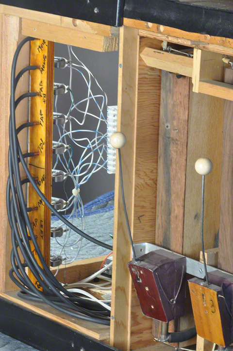 Detail of the bellows, mallets, and idiophone of Stephan van Huene's Tap Dancer, with piping and wiring