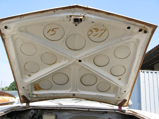 An early 1960's Corvair car hood, shown open to see underside