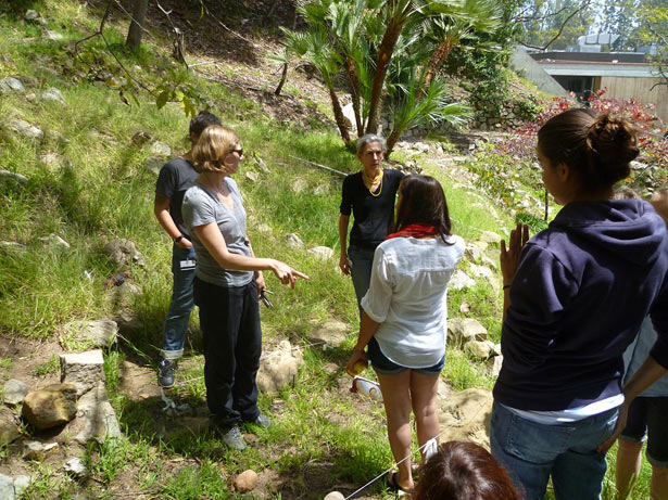 Dr. Sarah Lepinski instructs students in the UCLA/Getty program how to remove grass, leaves, and other material during an exercise dig at the Getty Villa