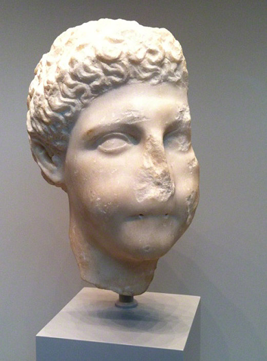 Head of a Boy Piper / Greek