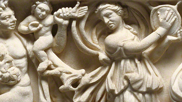 Detail of maenad playing a tympanum drum on Sarcophagus with Scenes of Bacchus / Roman