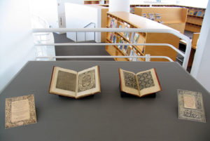 Pattern books from the GRI&#039;s collection in a display case, summer 2012