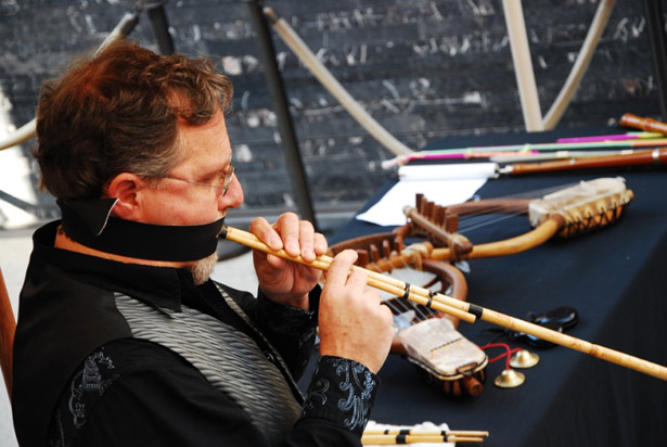 Roberto Catalano wears a phorbeia (leather strap) to play the benas, a Sardinian reed clarinet
