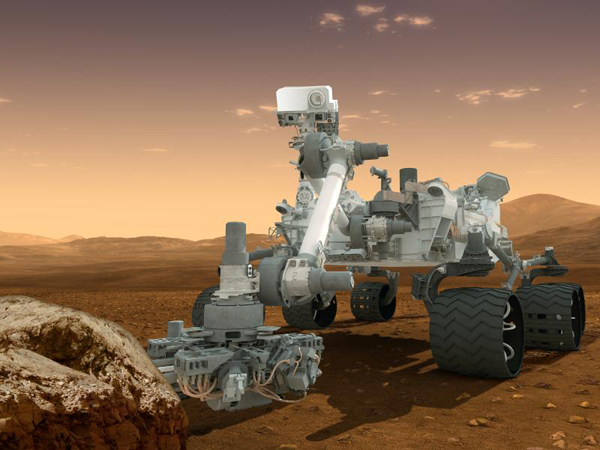 This artist's concept features NASA's Mars Science Laboratory Curiosity rover, a mobile robot for investigating Mars' past or present ability to sustain microbial life. Curiosity will land near the Martian equator about 10:31 p.m., Aug. 5 PDT (1:31 a.m. Aug. 6 EDT). In this picture, the rover examines a rock on Mars with a set of tools at the end of the rover's arm. Image credit: NASA/JPL-Caltech