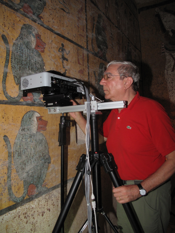 Giacomo Chiari, head of the science department at the Getty Conservation Institute, examines the painting on the west wall in the tomb of King Tutankhamen. Photo: Lori Wong (c) J. Paul Getty Trust