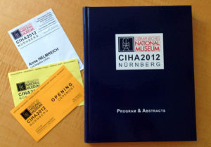 Program book and Anne Helmreich&#039;s attendee badge from the 2012 CIHA conference
