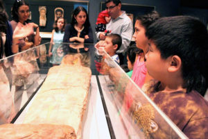 Visitors to the Getty Villa at a tour focusing on the mummy of Herakleides