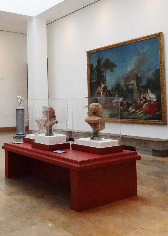 View of Boucher and red painted vitrines