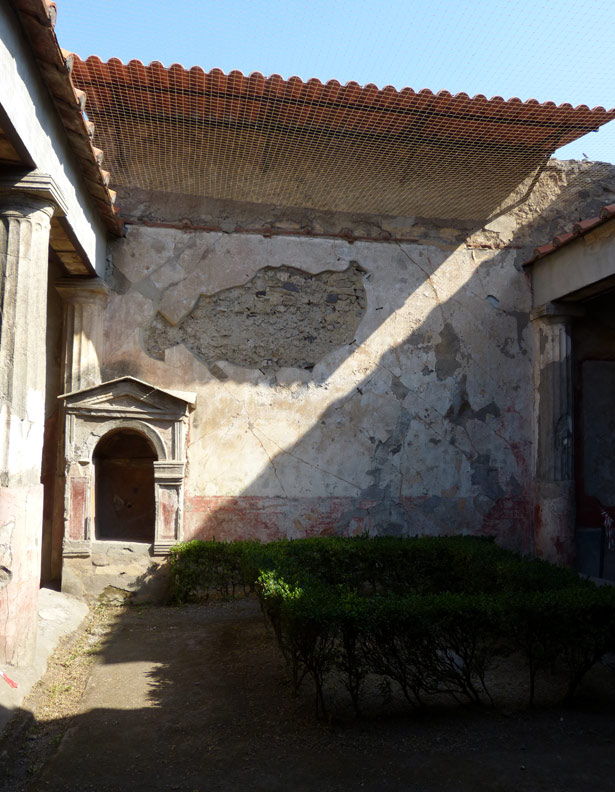 Recent photograph of the interior of the House of the Tragic Poet in Pompeii, showing loss of frescoes and stucco